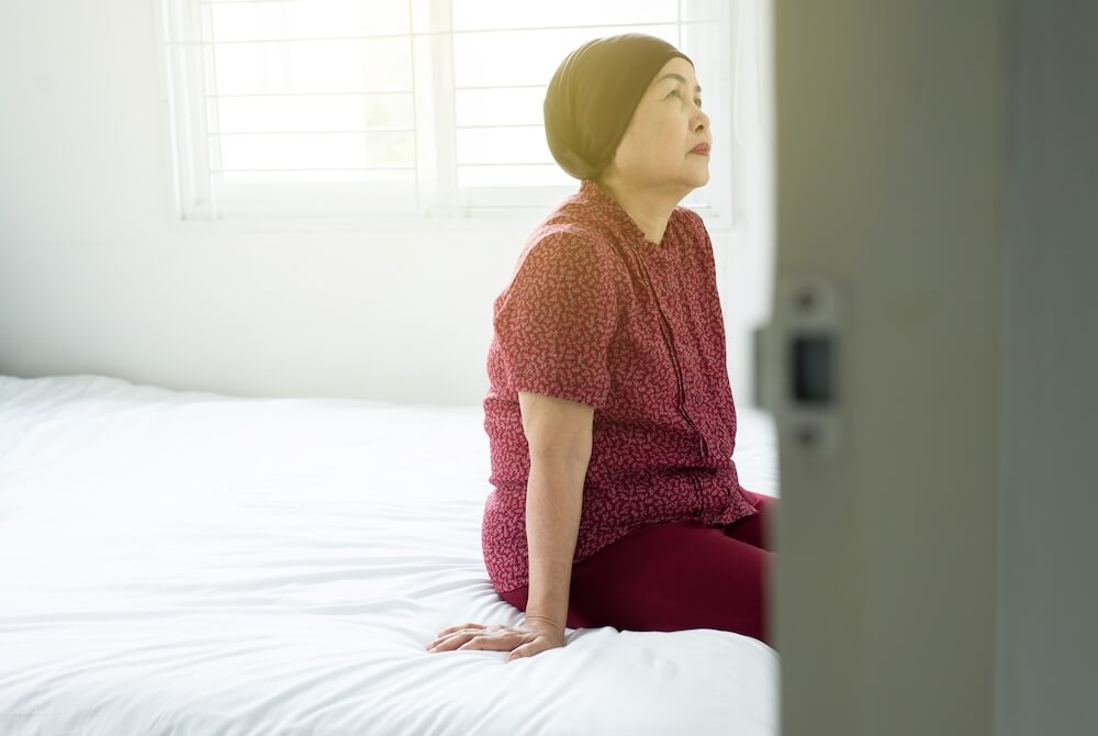 Senior Asian Woman With Disease Cancer Sitting In Her Bedroom Elderly Female Feeling Depressed And T20 Ozy00y